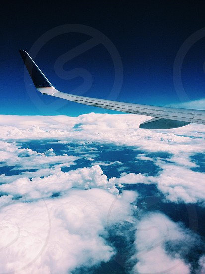 clouds and airplane wing photo