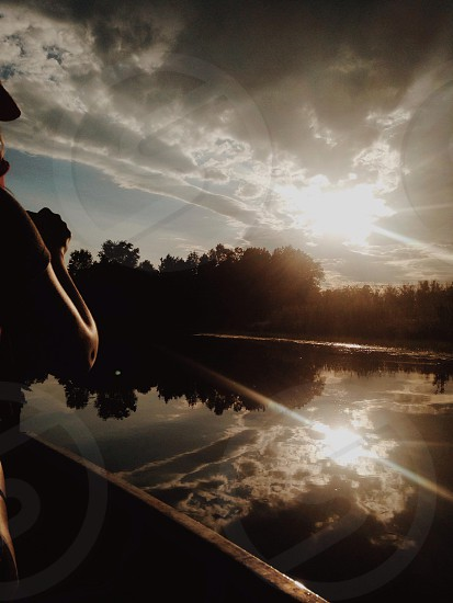 person riding boat during daytime photo