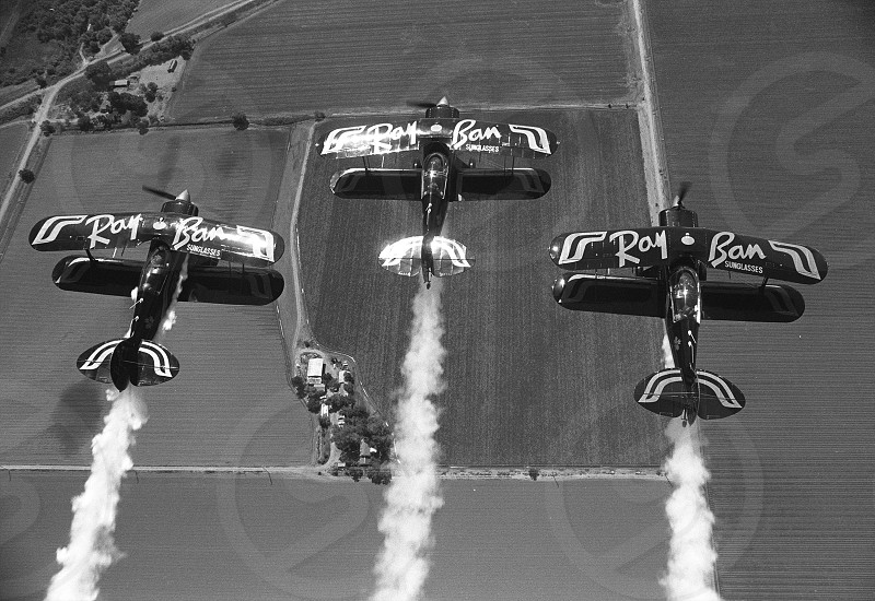 Flying with the Ray-Ban Gold Flyers the national stunt flying team of Canada 1988. photo
