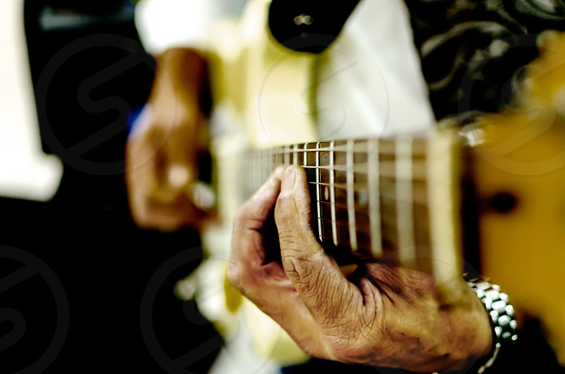 guitar guitarist musician background concert rock band play music instrument musical chord playing acoustic young player electric person closeup live white macro stage show performer club finger solo string fingers strings fretboard entertainment beautiful close hands soft blur female girl woman natural vintage man hand backdrop singer wood country party photo