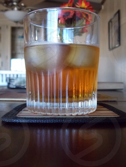drinking glass on a beige square coaster photo
