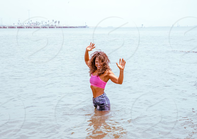 Athletic woman playing in the Ocean photo