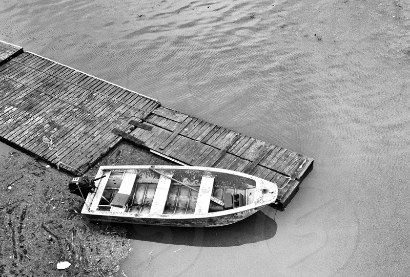 wooden motor boat on floating dock photo