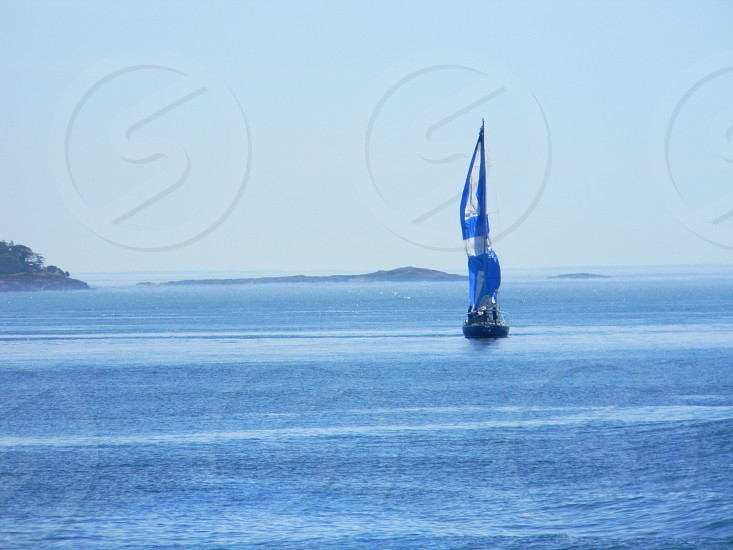 Sailboat in search of a breeze photo