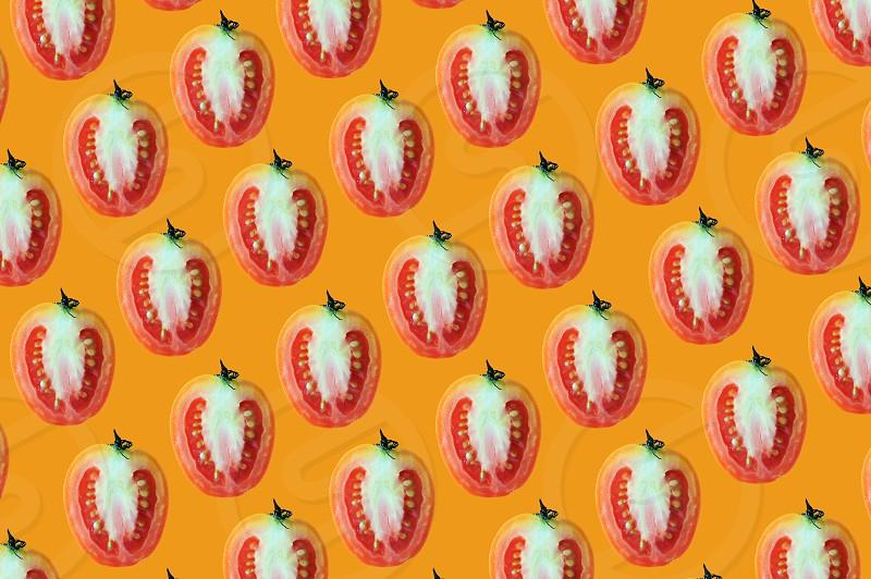 flat lay of beautiful trendy seamless pattern cherry tomato on orange background photo