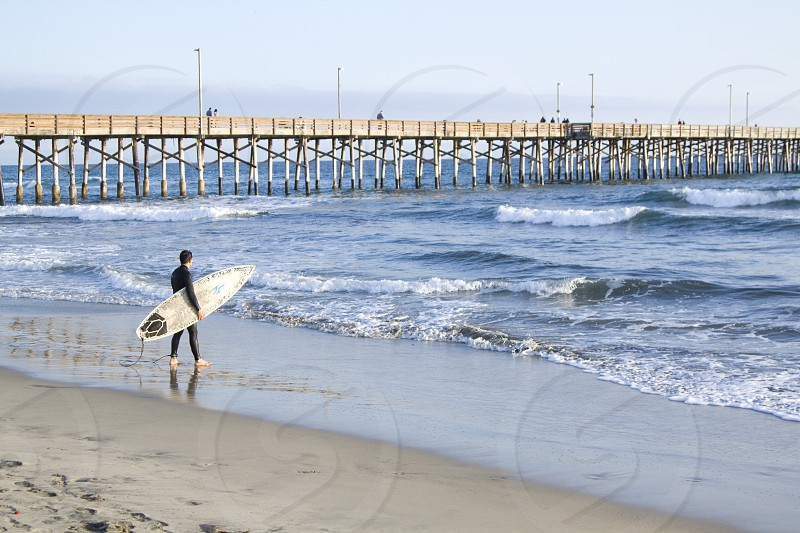 Newport Pier and Surfer photo