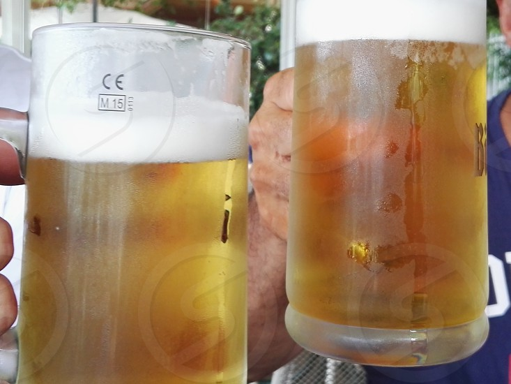 clear beer mug with beer content photo