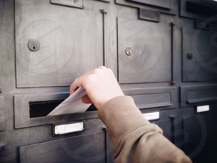 putting mail in postbox photo