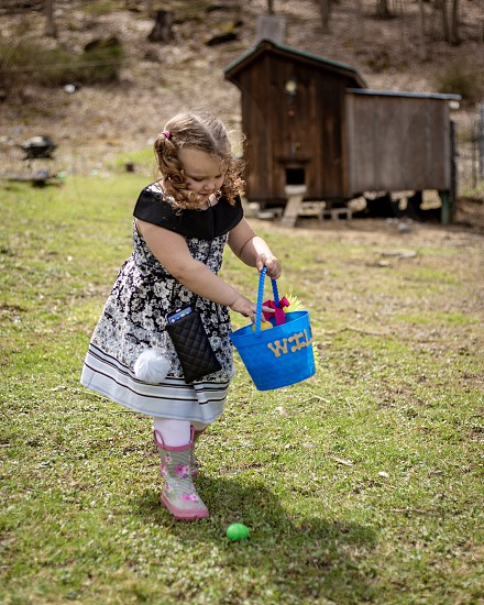 My youngest daughter grabbing eggs on a Easter egg hunt photo