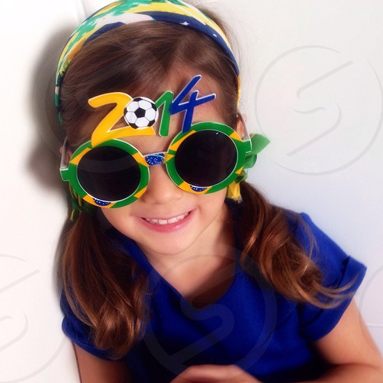 girl in blue t shirt wearing 2014 party glasses photo