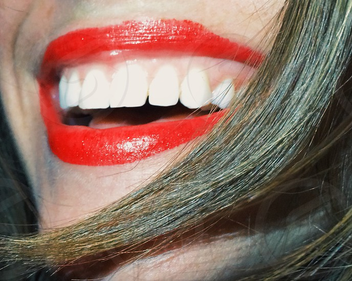woman with red lip stick photo
