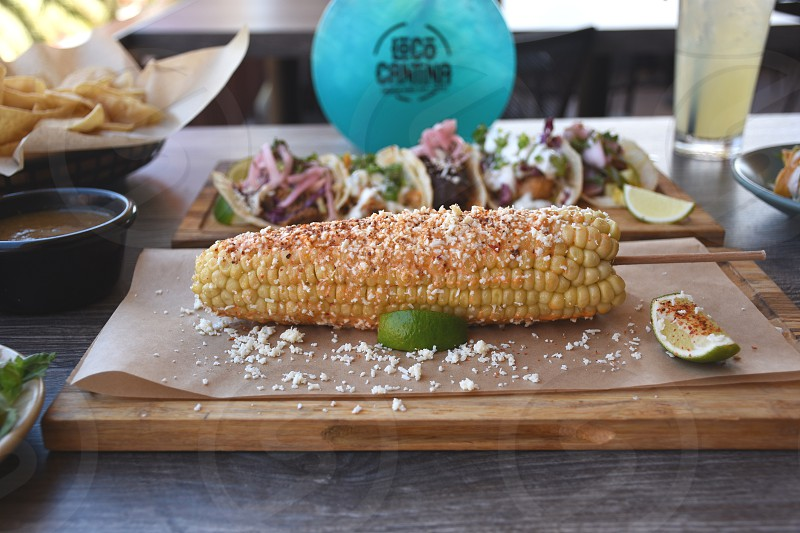 sweetcorn food on brown wooden food service tray photo