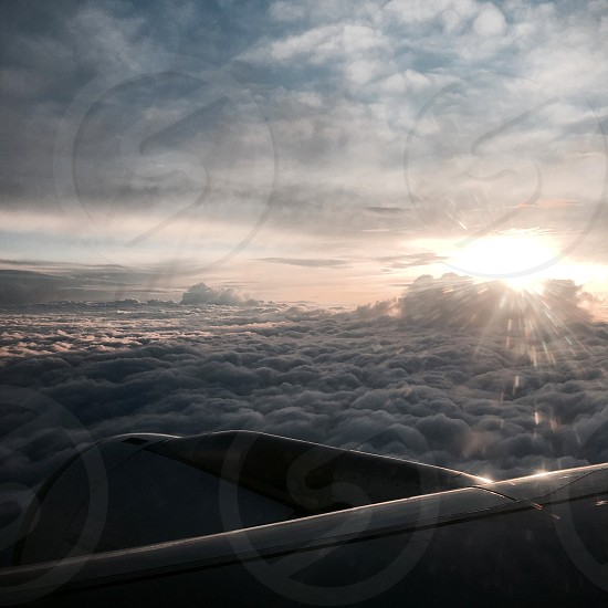 The rays of the sun above the clouds. At an altitude of nine thousand meters. Unique photo frames.  photo