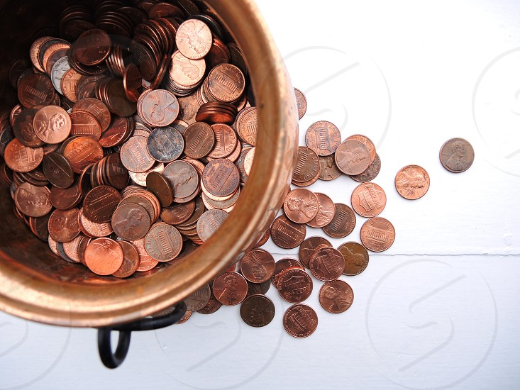 coins on brown bowl photo