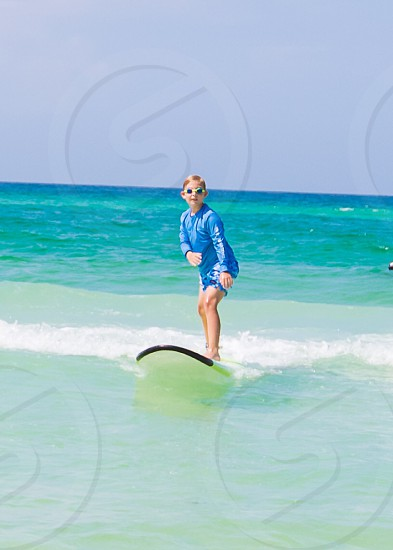 Surfing beach fun summer surf lesson ocean boy water photo