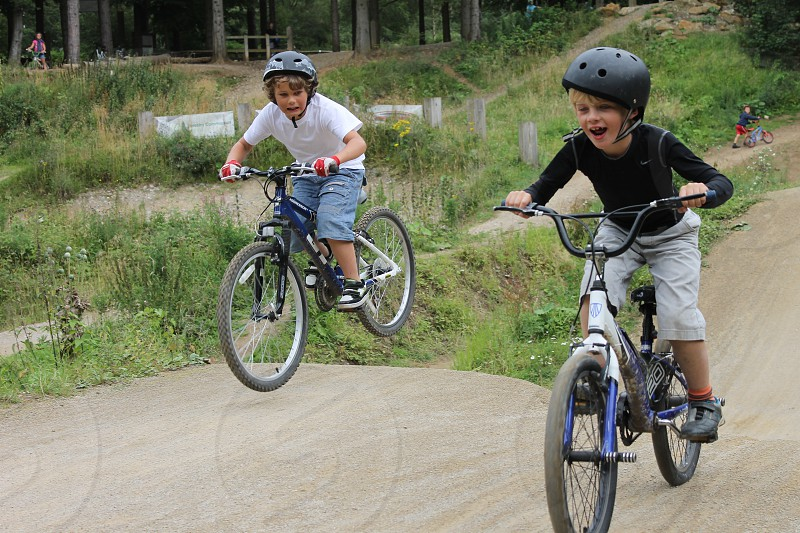Son and buddy on bikes photo