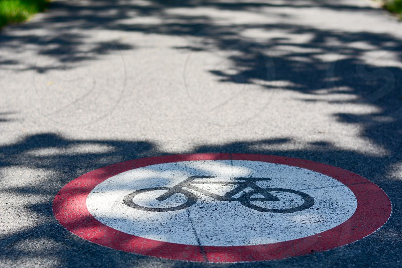 Bicycle path sign on the street. Photo was taken on a nice sunny day. Summer time. Focus is on the middle of the sign. photo