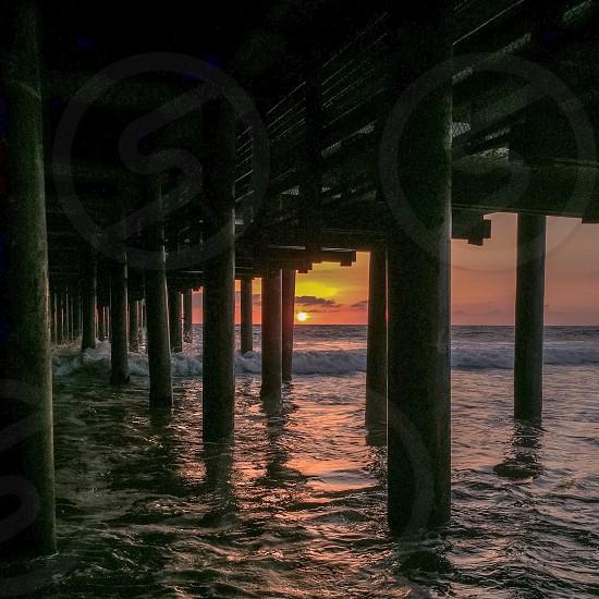 Sunset under the Santa Monica Pier Los Angeles CA  photo