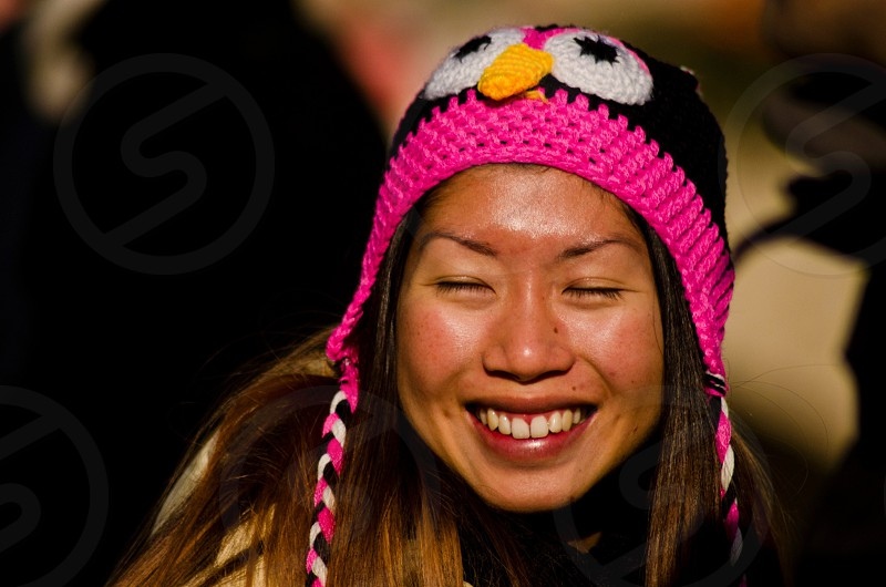 woman in pink and black crochet bonnet photo