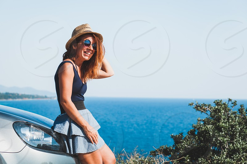 Young woman enjoying the view on a cliff photo