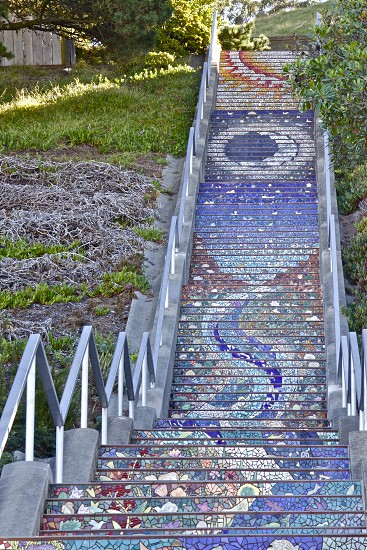 The colorful Moraga steps in San Francisco clear of people on a crisp sunny morning. photo