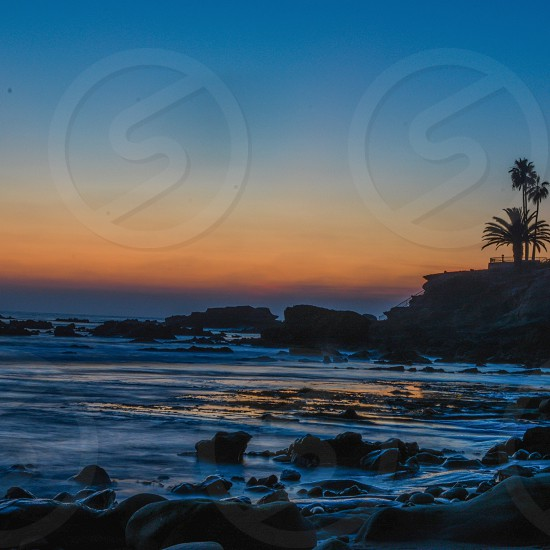 photo of ocean waves near seashore during sunset photo