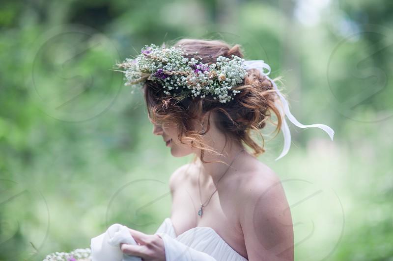 Wedding bride wreath flowers ribbon outdoor photo
