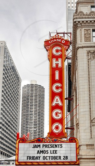 Chicago IL USA october 28 2016: The Chicago Theatre originally known as the Balaban and Katz Chicago Theatre is a landmark theater located on North State Street in the Loop area of Chicago. The Marina building in the distance photo