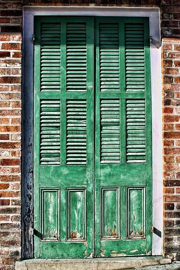 Old green exterior louvre doors photo