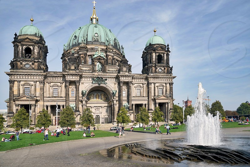 People Relaxing in Front of Berlin Cathedral photo