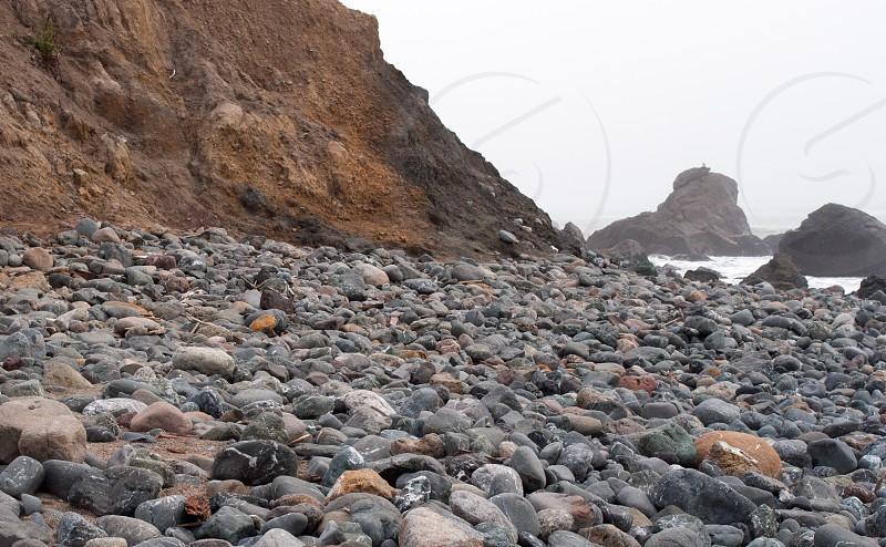 beach with rocks view photo