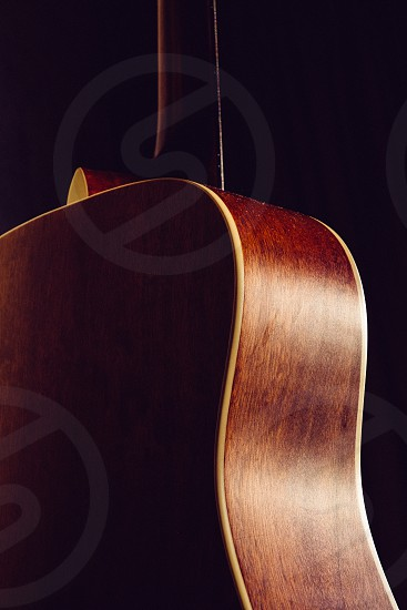 Guitar wood woodgrain acoustic shape curvy curved handmade crafted craft music musical instrument photo