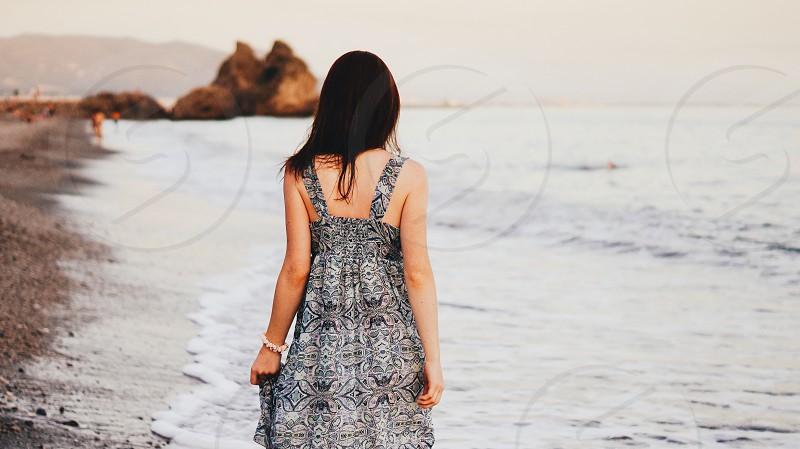 Harmony sea seashore girl woman back evening summer freedom nature photo