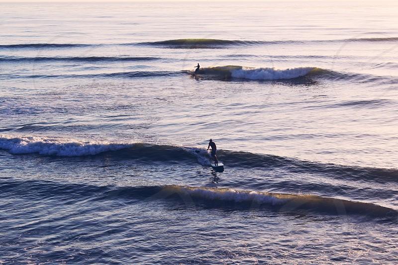 Ocean surfwaveswater paddlesunset photo