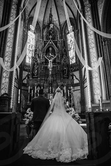 Bride and groom at church.  photo