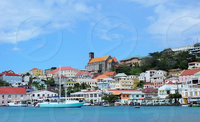 Church overlooking the port. #port #harbour #caribbean #boat #church #grenada #colorfulroofs #blue #sky #shadesofblue photo