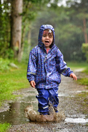 Jumping in a puddle in the rain  photo