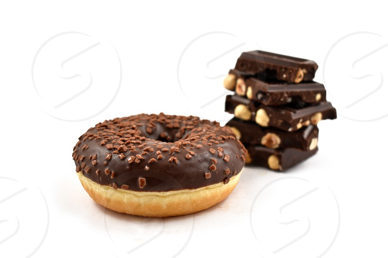 Chocolate donut and Pile of chocolate. Donut on a white background. Donut with chocolate frosting photo