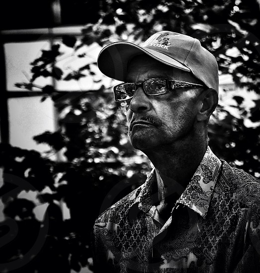 Man deep in thought in Bryant park photo