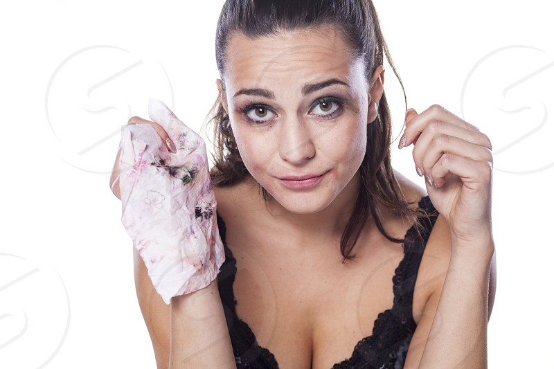 nice beautiful girl shows wet wipes by which removes her makeup photo