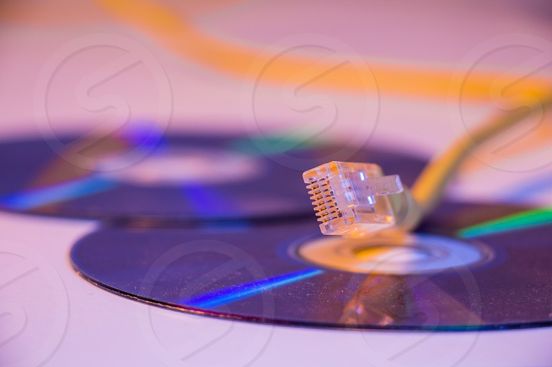 Closeup of Ethernet cable with it's reflection on blank disc. photo