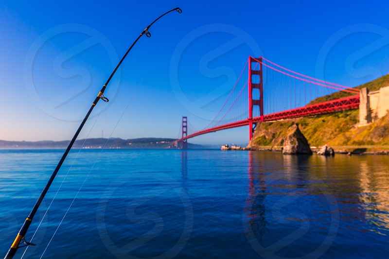 San Francisco Golden Gate Bridge with fishing rod California USA photo