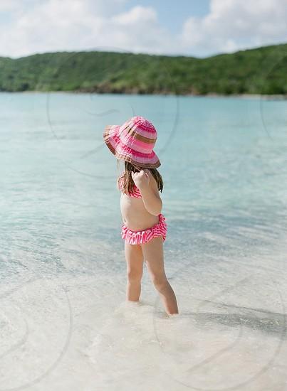 stylish style kid girl child summer bathing suit sun hat summer vacation family holiday travel destination ocean sea caribbean island islands photo