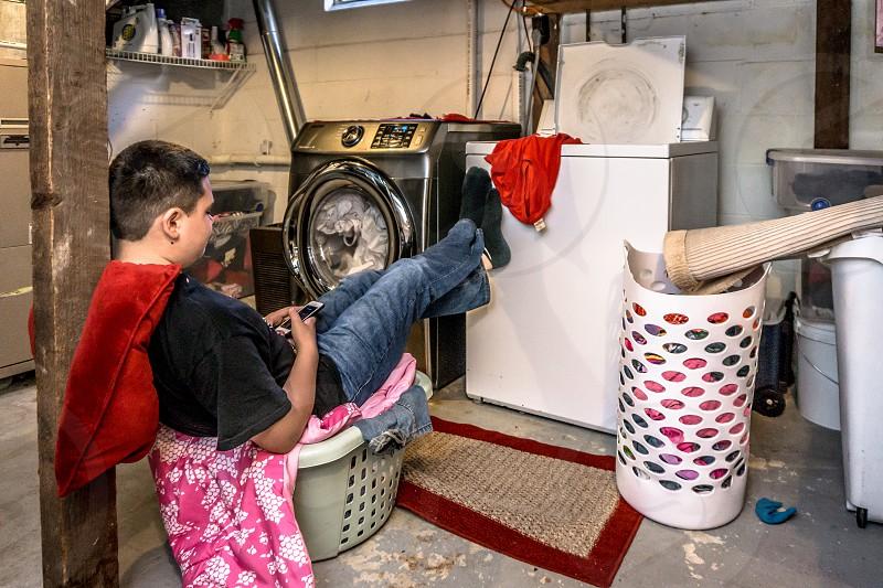 Kid laundry basket basement washer rustic photo