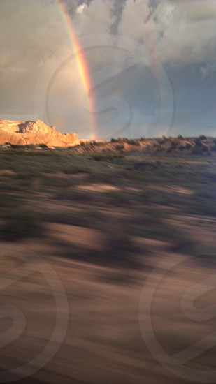 Illuminated rainbow shot from moving train. photo