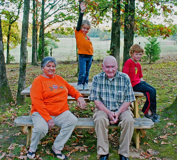 grandparents grandchildren fall kids family generations sassy little girl boy picnic table leaves autum photo