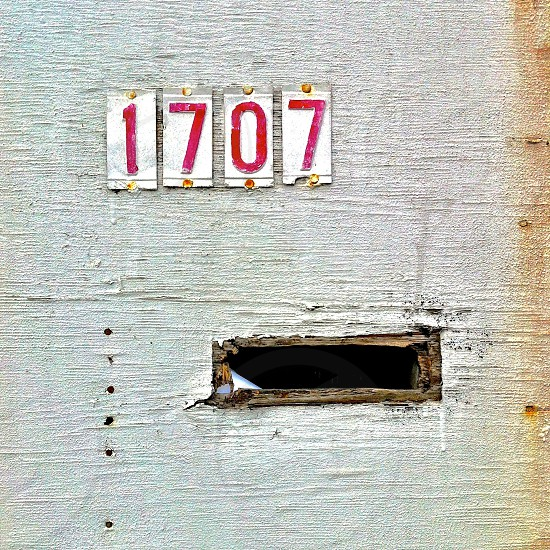 1707 signage on white surface photo