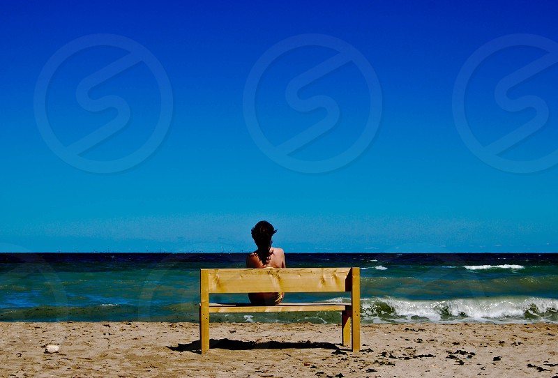 loneliness seaside woman alone blue landscape silence waves photo