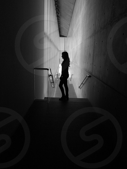 woman standing silhouette in building photo