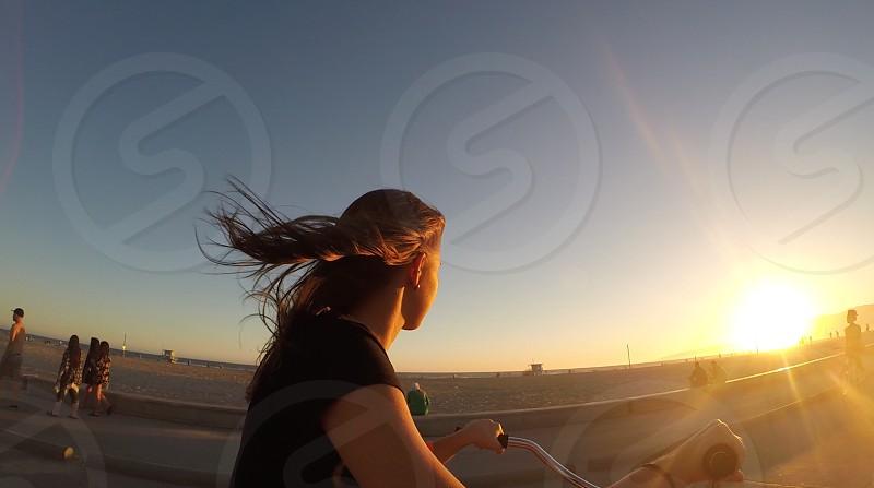 woman wearing a black t shirt riding a bike photo